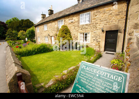 A row of 'plague cottages' where families affected by a plague died in Eyam village, Peak District, Derbyshire, - Stock Photo