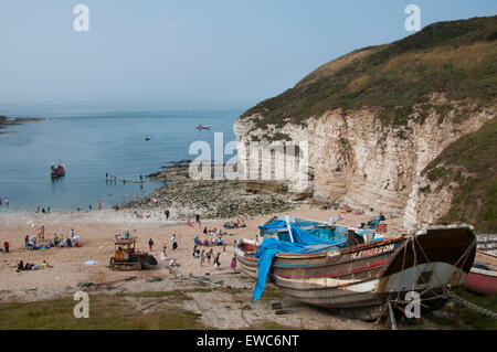 Old wooden fishing boat, chalk cliffs, people on the sunny summer sand & blue sky & sea - North Landing beach, Flamborough, - Stock Photo