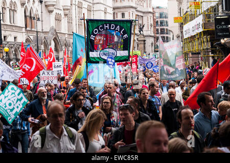 Protesters march against austerity in London with union banners and flags - Stock Photo
