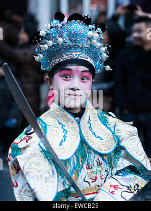 Paris, France - Feb 02, 2014: Chinese young man performs in traditional costume at the chinese lunar new year parade. - Stock Photo