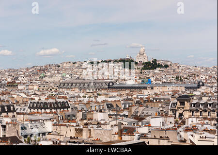 Paris roofs with montmartre on a sunny afternoon - Stock Photo