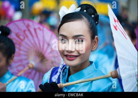Paris - February 17, 2013: Beautiful Chinese girl parades at the Lunar New Year Festival. - Stock Photo
