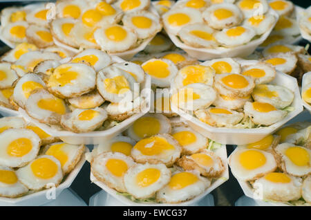 thailand fried quail eggs snack in Chatuchak market - Stock Photo
