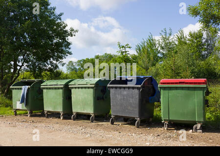 Dump of garbage and garbage containers in the village  landscape. Pollution of the nature concept. - Stock Photo