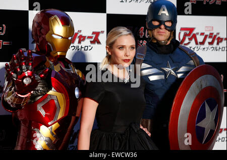 Tokyo, Japan. 23rd June, 2015. American actress Elizabeth Olsen (C) poses for photographers with Captain America - Stock Photo