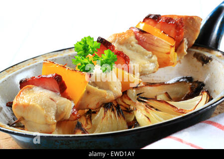 Chicken shish kebab with pan fried onion - Stock Photo