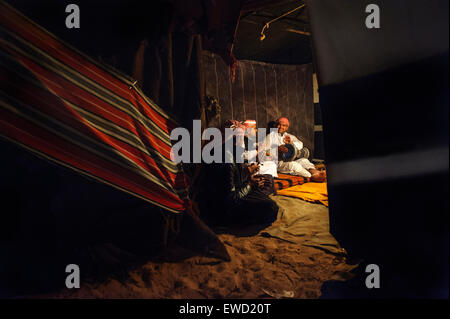 Local musicians playing in a Bedouin tent at night. Wadi Rum desert. Jordansights - Stock Photo