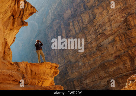 A local guide enjoys the view in Wadi Rum (The Valley Of The Moon), Jordan, Middle East - Stock Photo