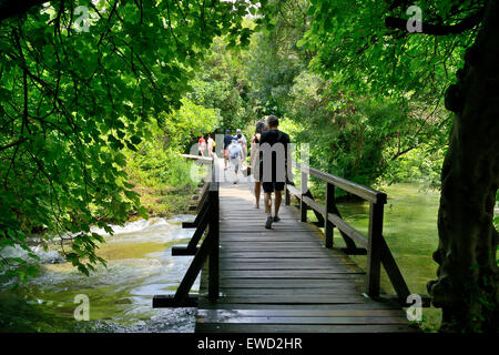 Tourists on boardwalk at Skradinski Buk waterfalls, Krka National Park on Dalmatian Coast of Croatia - Stock Photo