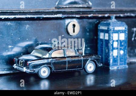 dinky police car on duty outside of safe box. - Stock Photo