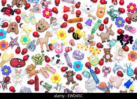 Childrens buttons, badges and plastic toys pattern on white background