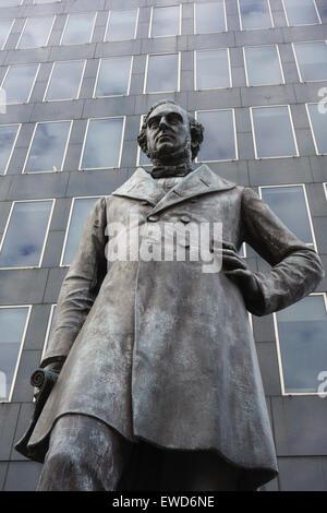 Statue of Victorian railway engineer Robert Stephenson (1803-1859) inventor of the Rocket steam locomotive outside - Stock Photo