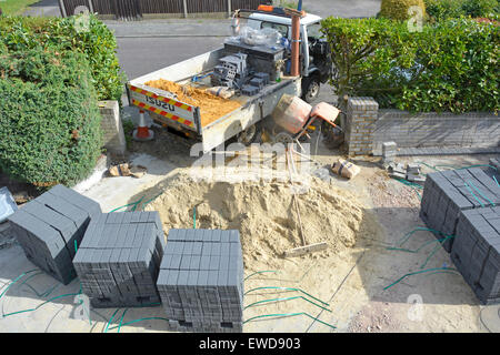 Home improvement front garden of residential property creating a new car driveway after removal of old concrete - Stock Photo