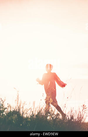 Woman Running to Freedom Through Countryside Field, Silhouette of Female Person, Double Exposure, Vintage Retro - Stock Photo