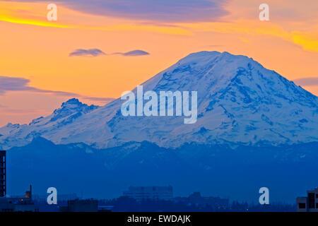 Sunrise above Mount Rainier (facing west) in Washington State, USA. - Stock Photo