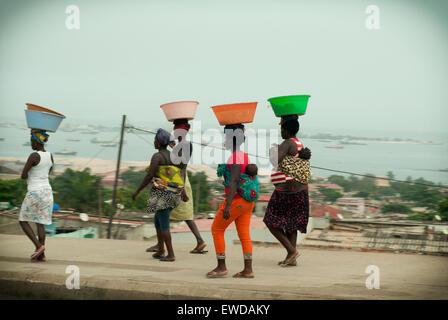 Angolan women during their daily life - Stock Photo
