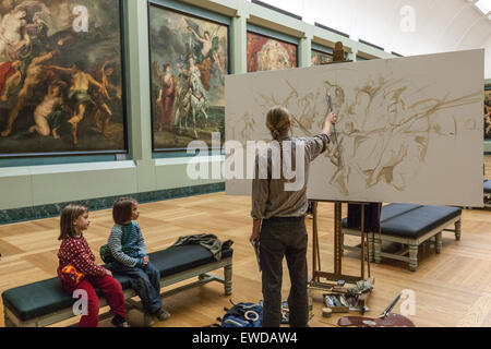 Children looking an artist copying in the Galerie Médicis by Rubens. Louvre Museum - Stock Photo