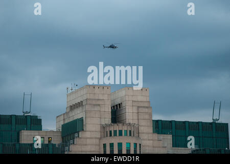London, UK. 22 June, 2015. A helicopter flies over the MI6 building during filming of the new James Bond movie Spectre. - Stock Photo