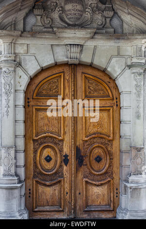 Decorative wooden door of a building in the old town of Lucerne, Switzerland - Stock Photo