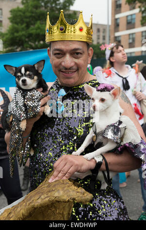 New York, NY USA - June 20, 2015: Designer Anthony Rubio with his dogs attends 33rd Mermaid parade on Coney Island - Stock Photo