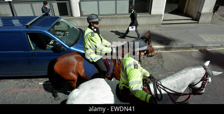LONDON - MAY 12 2015:Metropolitan Police Service Mounted officers.Police across Britain have been put on high alert - Stock Photo