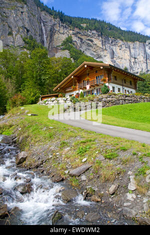 Farmhouse below Spissbach Falls in the Lauterburnnen Valley - Stock Photo