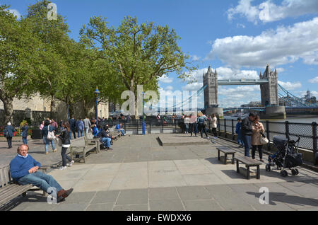 LONDON, UK - MAY 12 2015:Visitors and The Tower Bridge spanning over River Thames as view from London borough of - Stock Photo