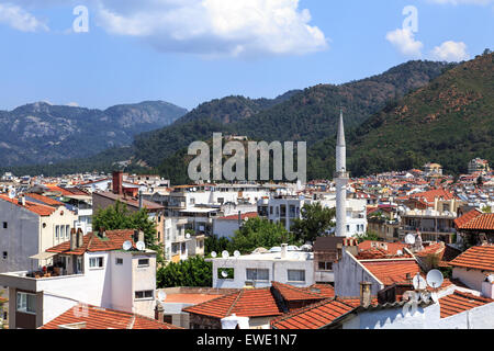 MUGLA, TURKEY - JUNE 1, 2015 : Top view of Marmaris town, roofs of the old houses, on cloudy sky background. - Stock Photo