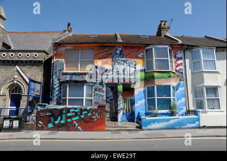 Brighton UK  June 2015 - Homes in Viaduct Road adorned with large murals painted by famous graffiti artist AroeMSK - Stock Photo