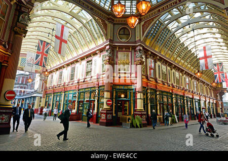 LONDON - MAY 13 2015:Pedestrians in Leadenhall Market in London, UK.It's one of the oldest markets in London, dating - Stock Photo