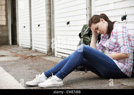Homeless Teenage Girl On Streets With Rucksack - Stock Photo