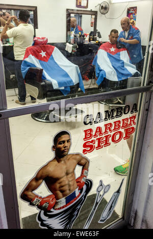 Miami Florida Little Havana Gamboa Barber Shop Cuban flag Hispanic man cutting hair customer inside - Stock Photo