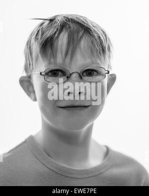 Black and white portrait of 9 year old Icelandic boy with glasses. - Stock Photo