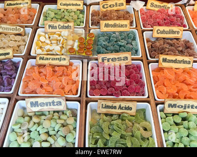 Assortment of colorful candy for sale in bins, Alicante, Spain - Stock Photo