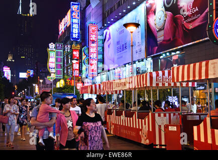Night View of Nanjing East Road  ( Neon signs lit on )  The street is the main shopping road of the city. Shanghai - Stock Photo