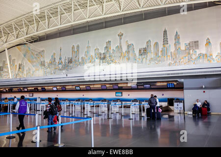 New York City NY NYC Queens John F. Kennedy International Airport JFK inside terminal concourse gate area mural - Stock Photo