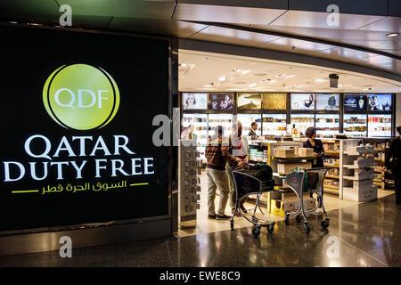 Qatar Doha Hamad International Airport DOH terminal concourse gate area inside interior shopping QDF Duty Free English - Stock Photo