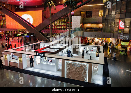 Qatar Doha Hamad International Airport DOH terminal concourse gate area inside interior shopping Dior women's makeup - Stock Photo