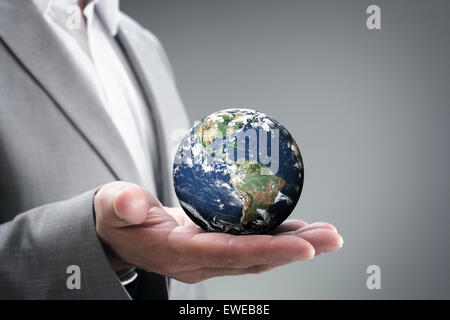 Businessman holding the world in his hands - Stock Photo