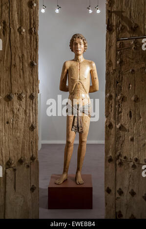 London, UK.  24 June 2015. A 14th century wooden statue from Saint Sebastian, at the preview of Masterpiece London, - Stock Photo