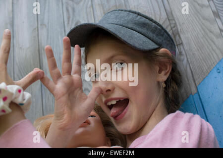 Girl Sticking Out Her Tonque - Stock Photo