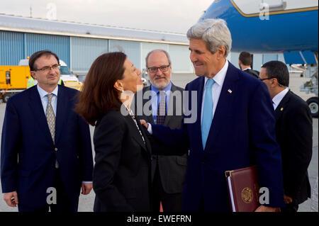 Swiss diplomatic officials look on as U.S. Secretary of State John Kerry chats with Ambassador Pamela Hamamoto, - Stock Photo