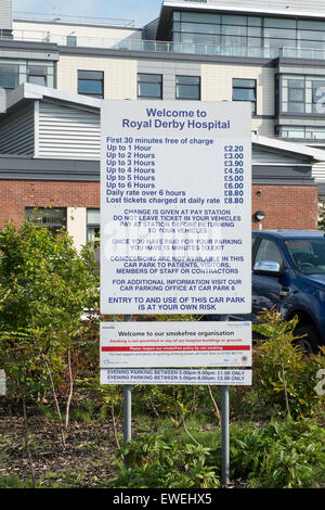 Sign displaying parking charges, Royal Derby Hospital - Stock Photo