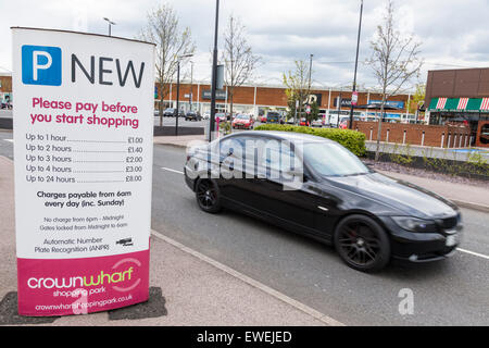 Car leaving a retail park with parking charges. Crown Wharf Shopping Park, Walsall, West Midlands, England, UK - Stock Photo