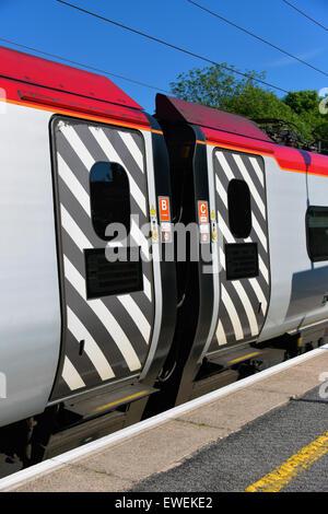 Sliding doors. Virgin Class 390 Pendolino passenger train. - Stock Photo