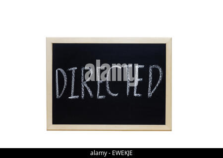 DIRECTED written with white chalk on blackboard. - Stock Photo