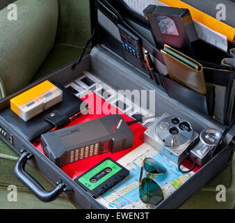 1980's briefcase with typical 80's era business items including Mobira Cityman mobile phone, VHS cassette, Olympus - Stock Photo