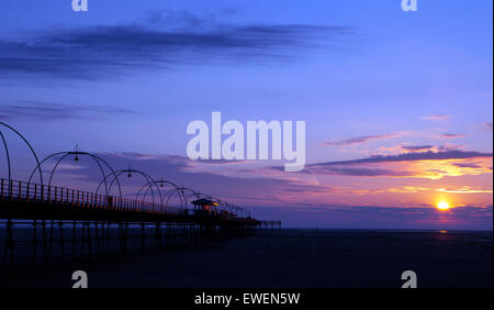 Southport, UK. 24th June, 2015. A stunning sunset reveals itself after a very humid & overcast day in Southport, - Stock Photo
