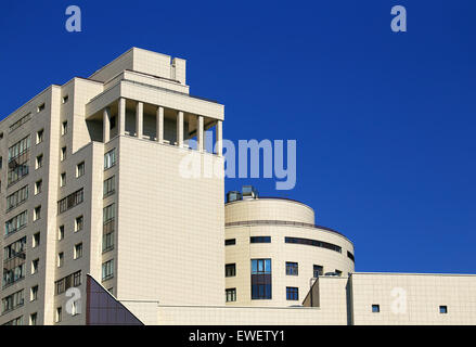 Facade of a massive building with galleries and balconies - Stock Photo