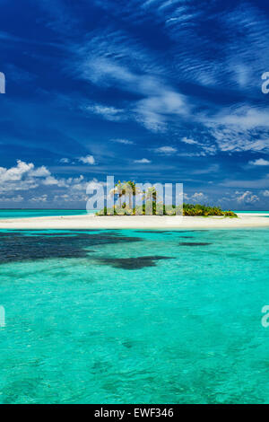 Small island surrounder by reef and amazing beach in Maldives - Stock Photo